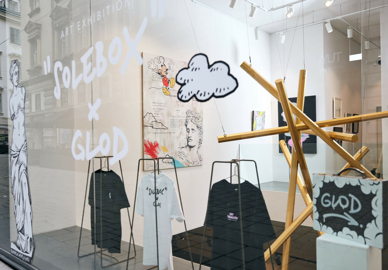 Glod Art - Exhibition and Cooperation with Solebox Store Art Space in Vienna. Store Window with Artworks and T-Shirts by Glod.